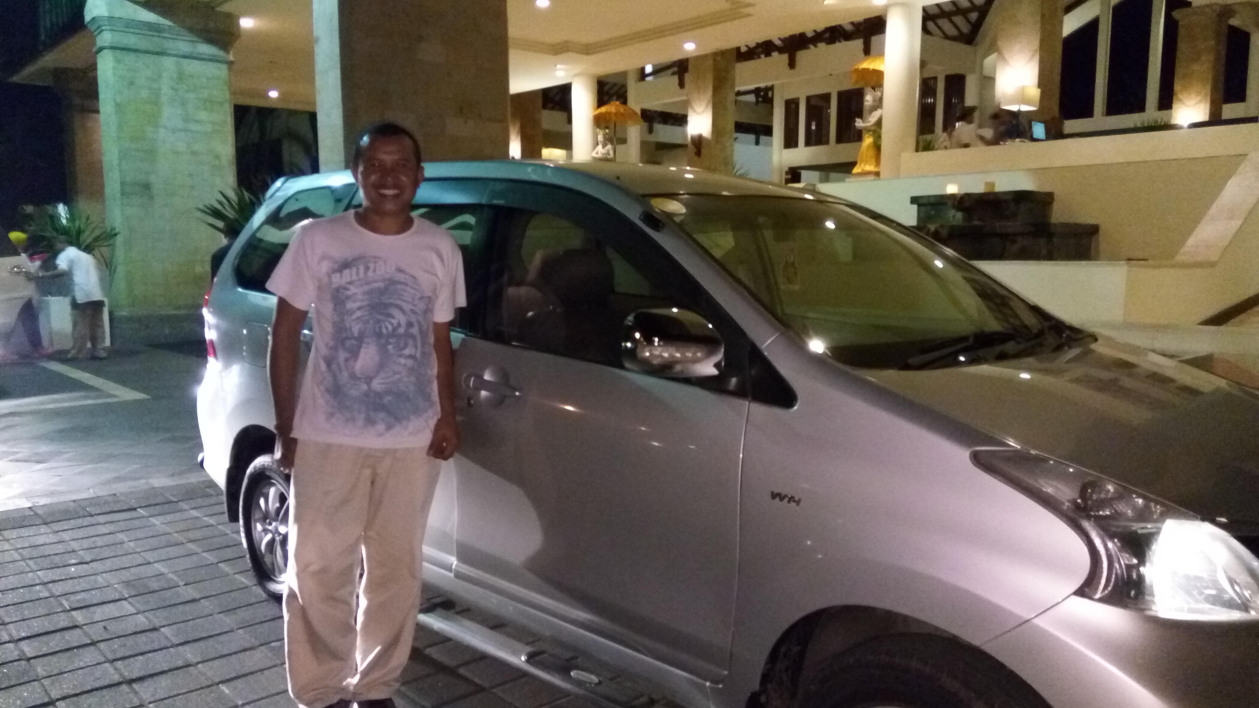 Wayan Merta with his car, Bali