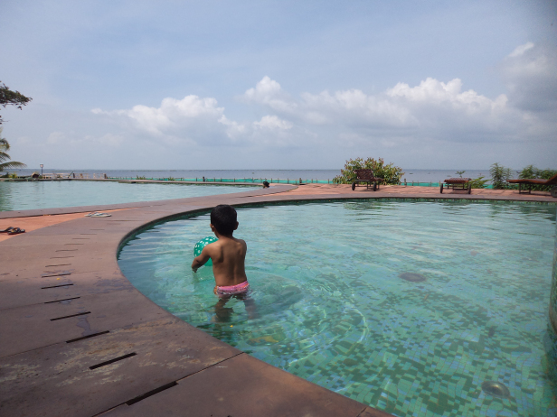 Kiddo enjoying in the kids pool at KTDC Waterscapes, Kumarakom, Kerala. Awesome view of the lake beyond the pool.